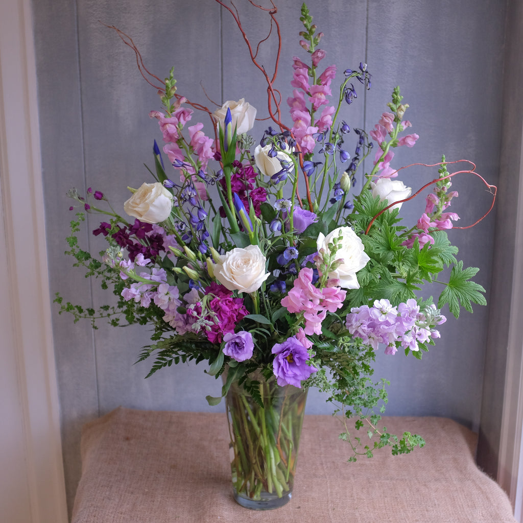 tall and elegant floral arrangement with roses, lisianthus, stock, and natural accents by Michler's Florist in Lexington, KY