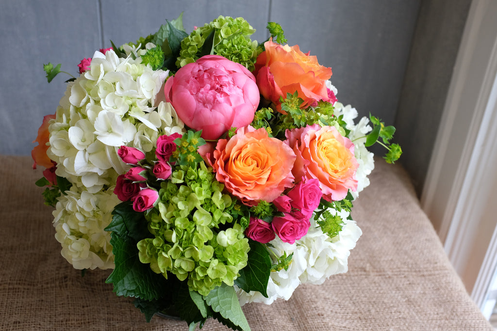 Lush and cheerful flower bouquet designed by Michler's Florist
