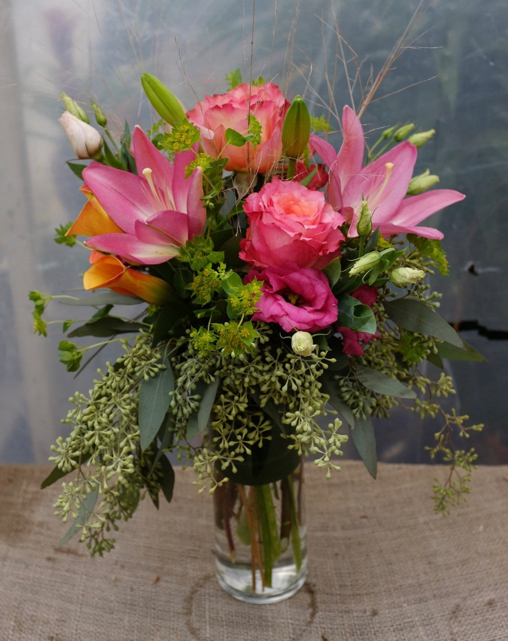 Miami Flower Arrangement with pink lilies and bicolor orange roses. Designed by Michler's in Lexington, KY