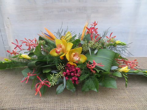 Naples: Thanksgiving floral centerpiece with Cymbidium Orchids, Birds of Paradise, and Aranthera Orchids | Michler's Florist