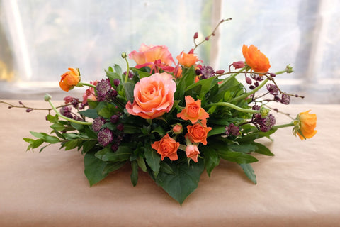 Norland: Thanksgiving centerpiece with roses, ranunculus and orchids. Michler's Florist in Lexington, KY