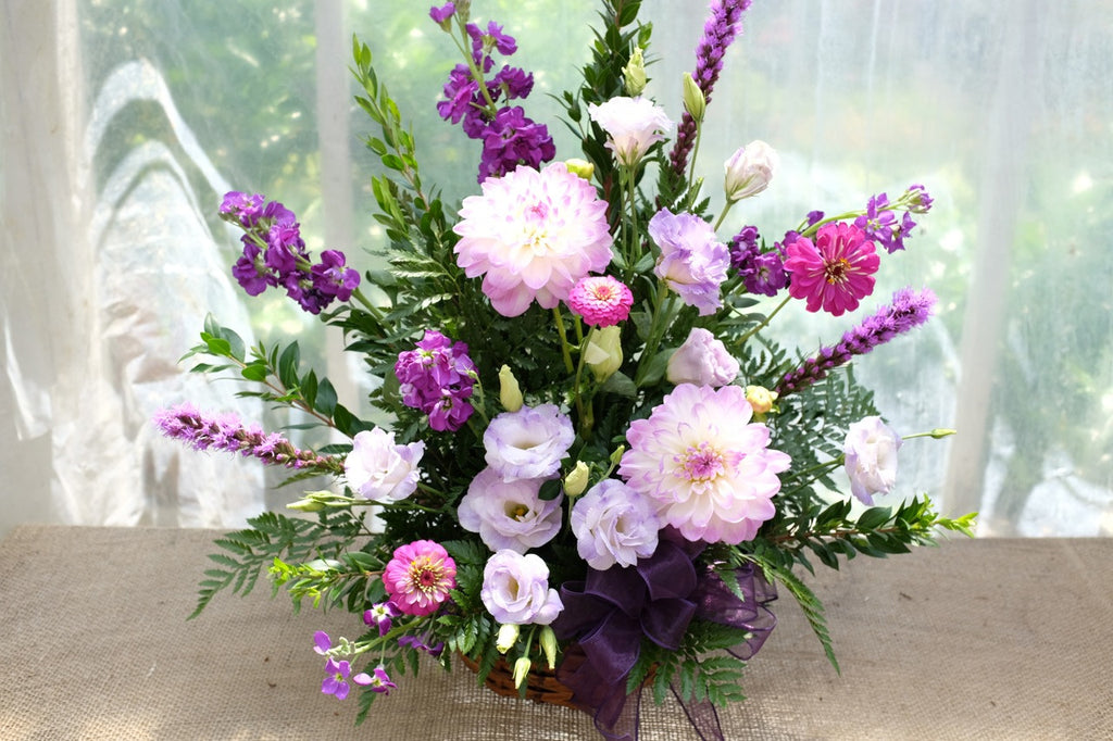 Funeral Basket with lavender Lisianthus, Light pink Dahlias, Liatris, and Stock. | Michler's Florist