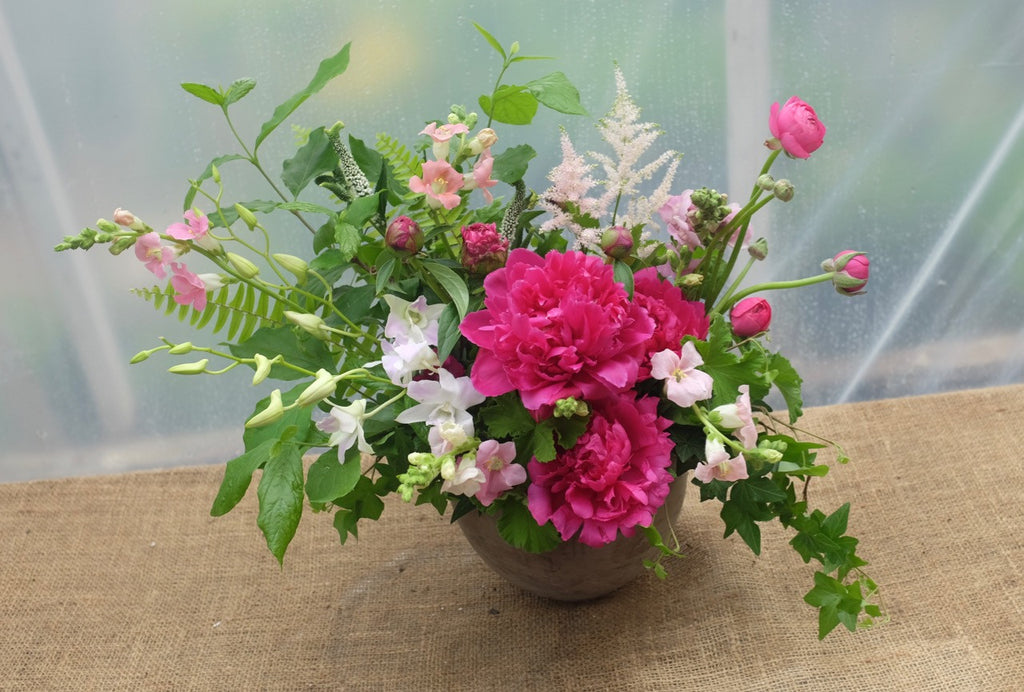 Pamplona: Garden flower design with Peonies, Astilbe, and Dendrobium Orchids