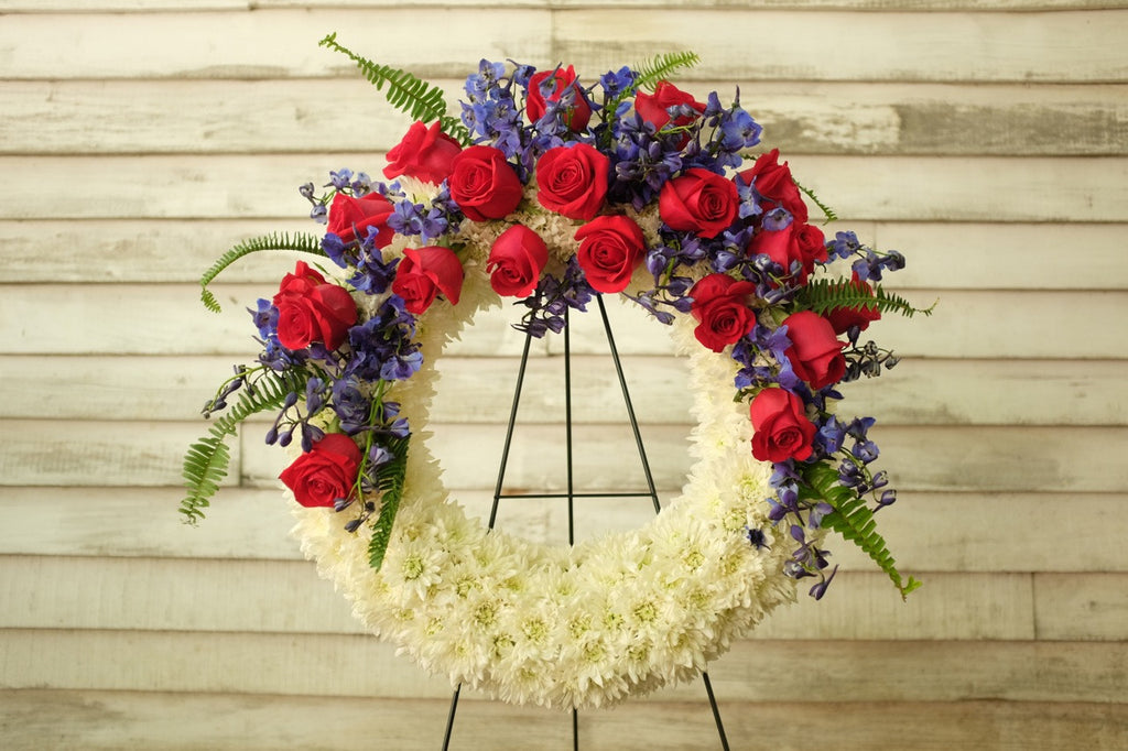Patriotic Funeral Wreath with White Cusion Mums, Red Roses and Blue Delphinium