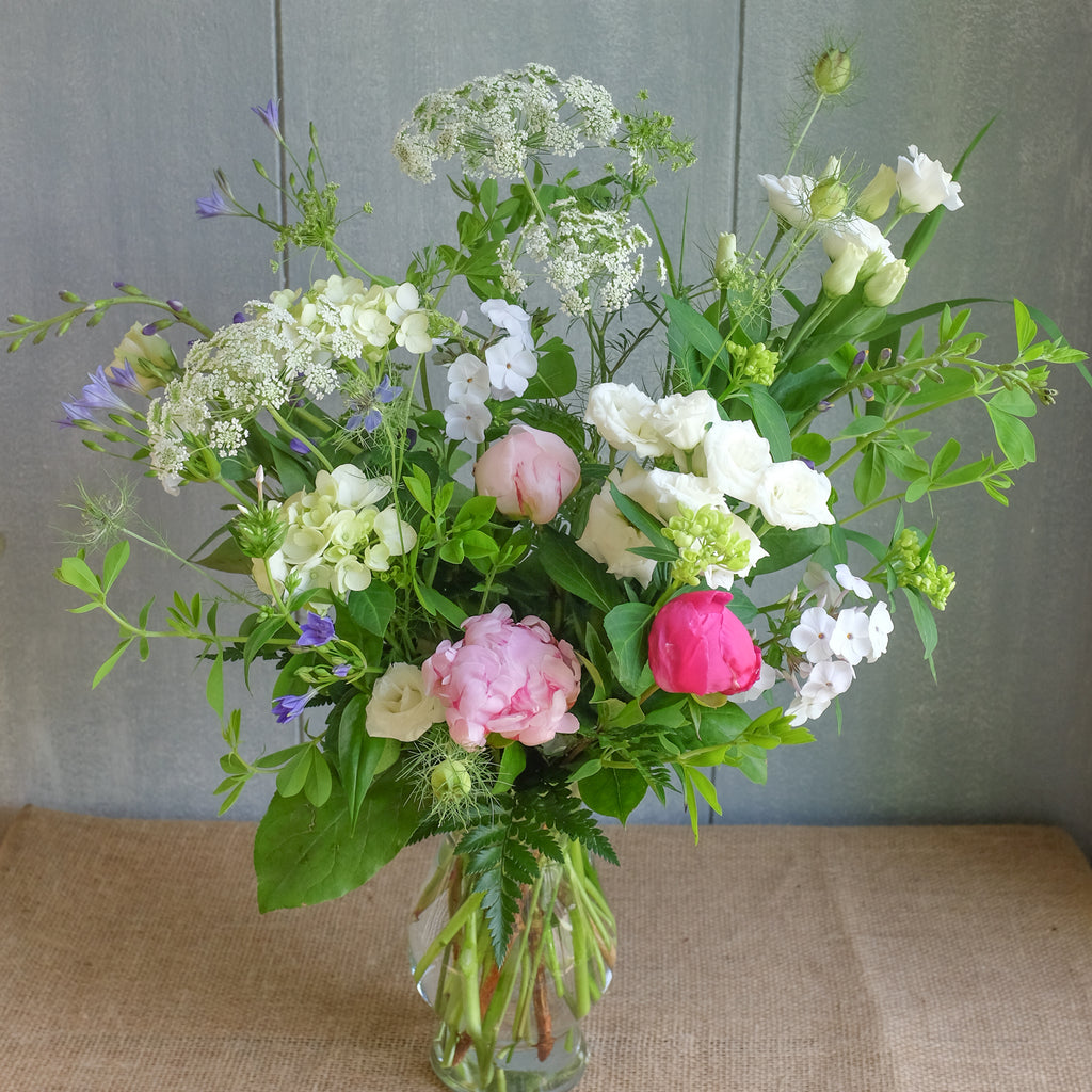 Field bouquet with peonies and baptesia.