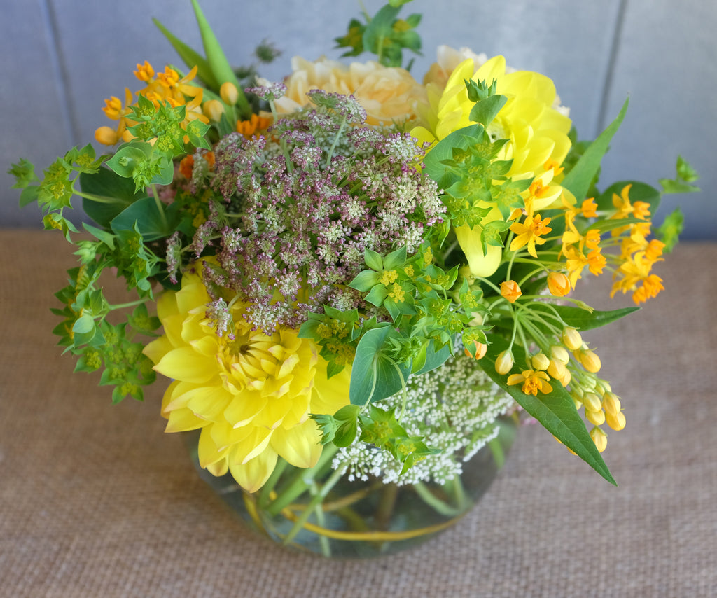 Lush Bouqet of bright garden flowers and textured foliage