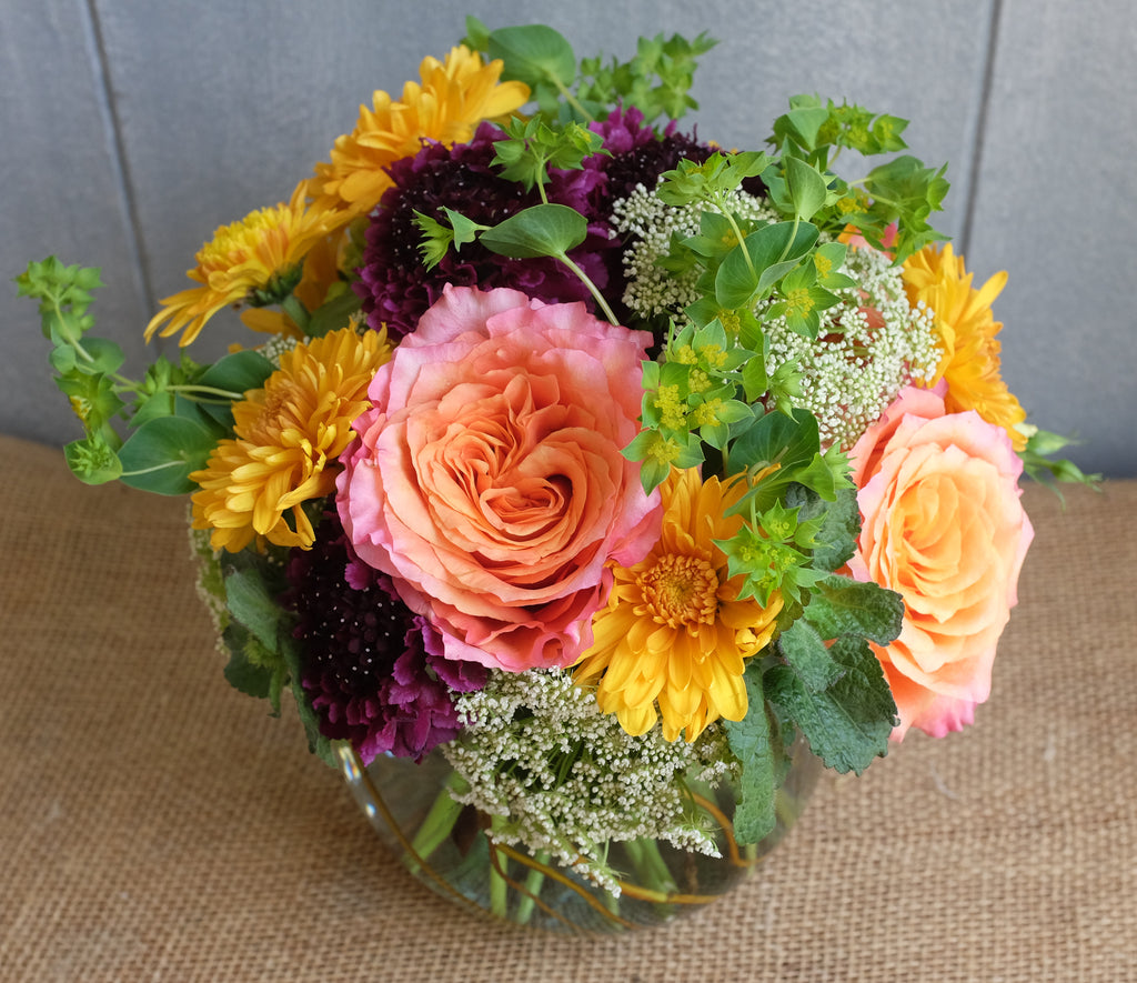 Lush composition of flowers in a vase designed by Michler Florist.