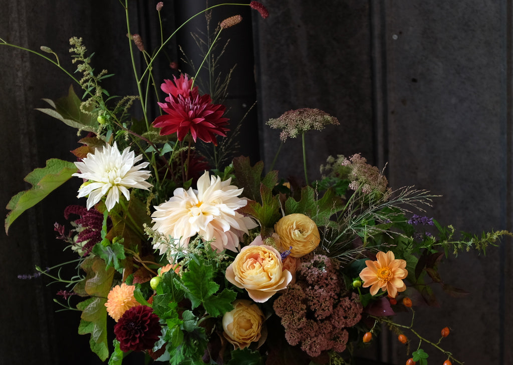 Dynamic bouquet with garden roses, dahlias and field flowers