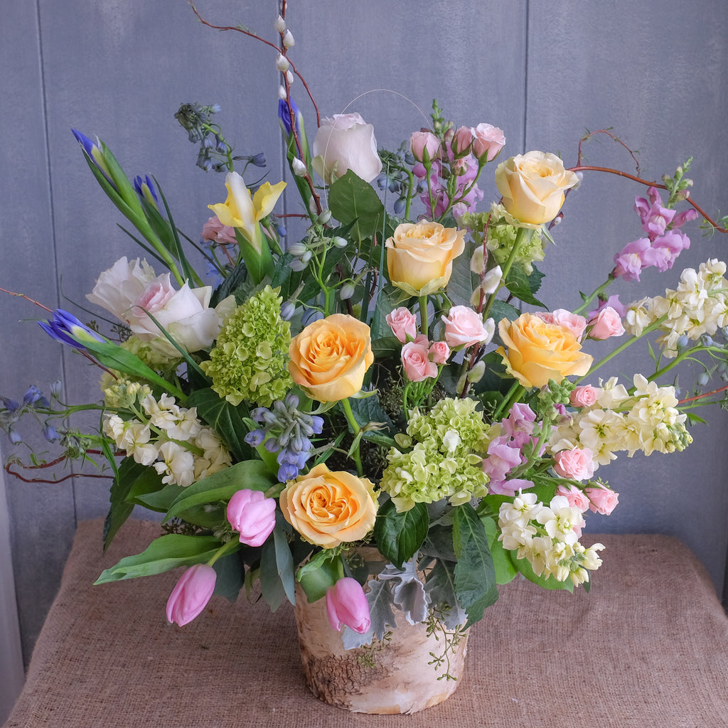 Pastel flower arrangement by Michlers Florist.