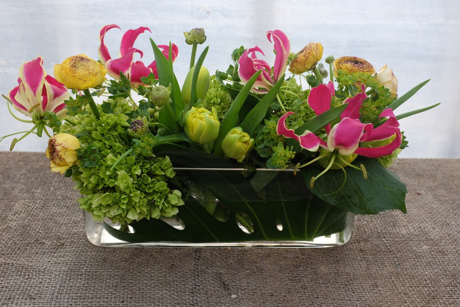 Centerpiece with Gloriosa Lilies, Double Tulips and Ranunculus. Designed by Michler's in Lexington, KY