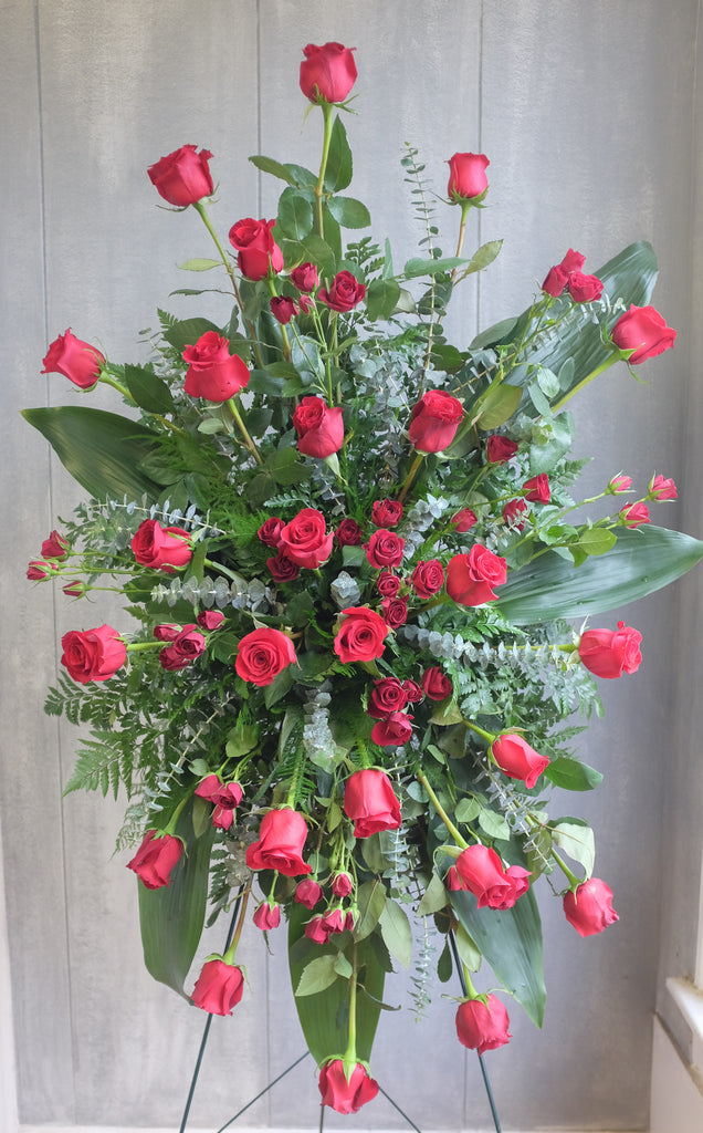floral easel spray with red roses, eucalyptus, and greenery by Michler's