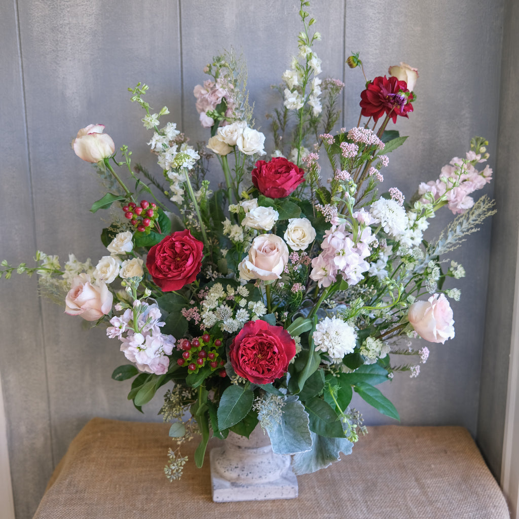 tall and elegant floral arrangement with roses, stock, and seeded eucalyptus by Michler's