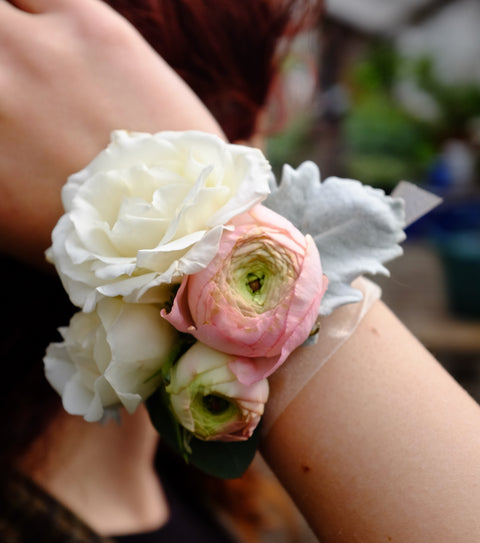 Wrist Corsage with Ranunculus and Roses | Michler's Florist