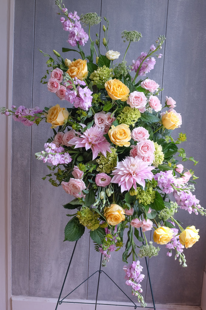 floral easel spray with roses, hydrangea, and stock by Michler's