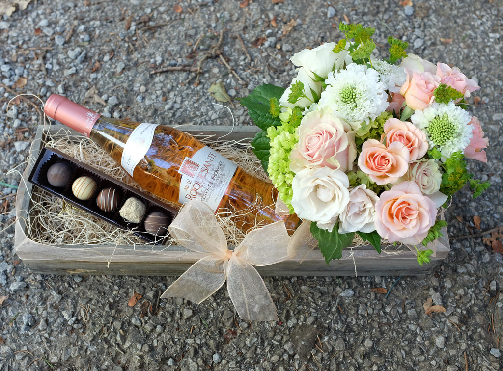 Gift crate with wine flowers and chocolates