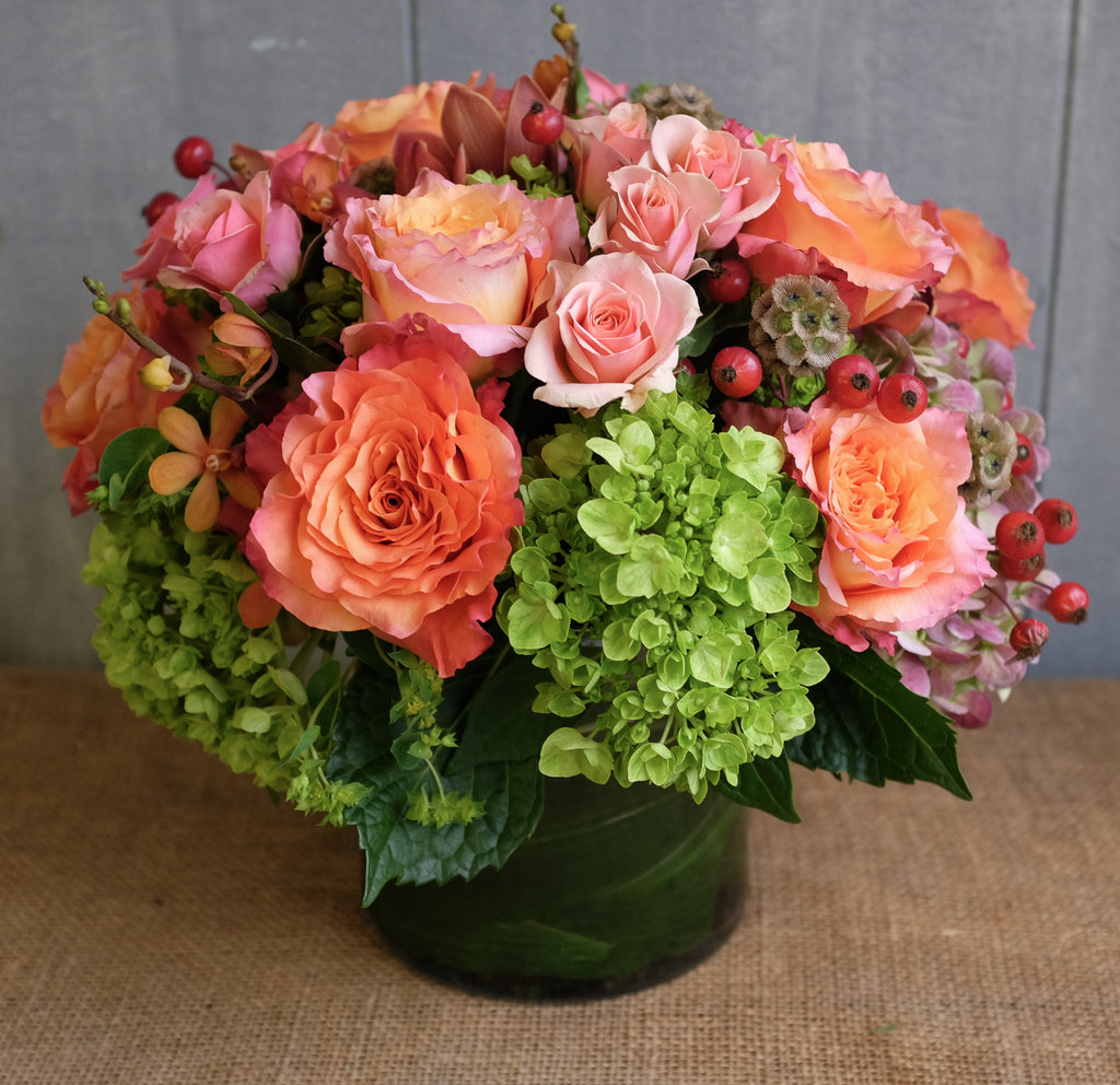 Bright and warm seasonal low and lush design with unique accents by Michler's Florist