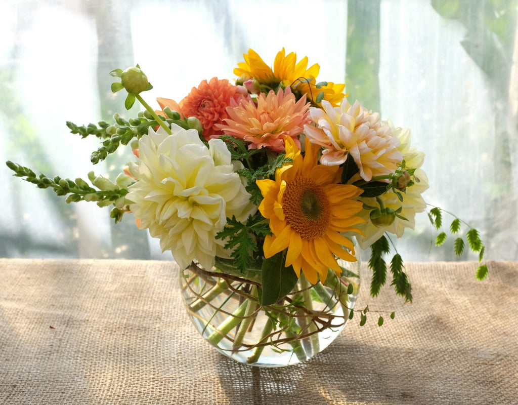 Flower arrangement with yellow and orange Dahlias and Sunflowers | Michler's Florist
