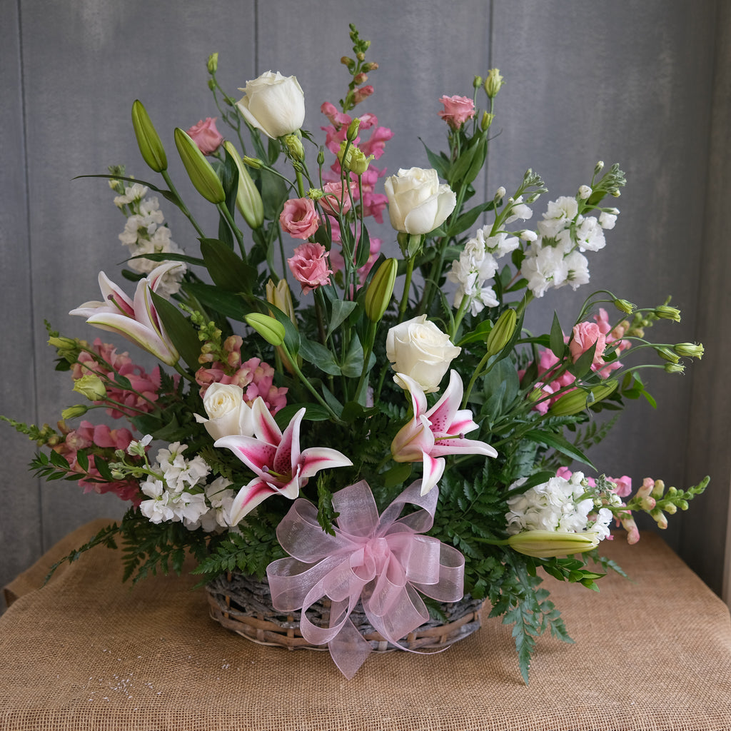 floral funeral basket with stargazer lilies, roses, lisianthus, and stock by Michler's Florist in Lexington, KY