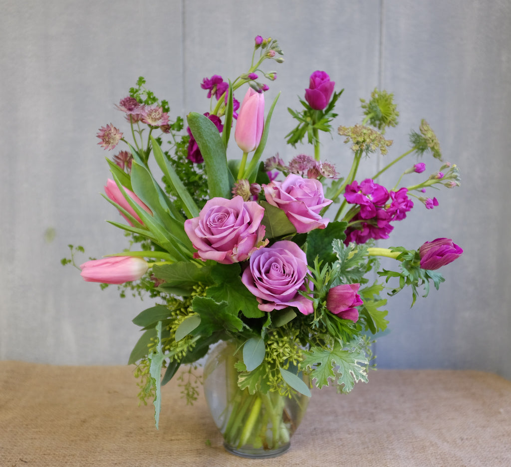 Flower bouquet with lavender roses, pink tulips, fuchsia anemones by Michler's Florist