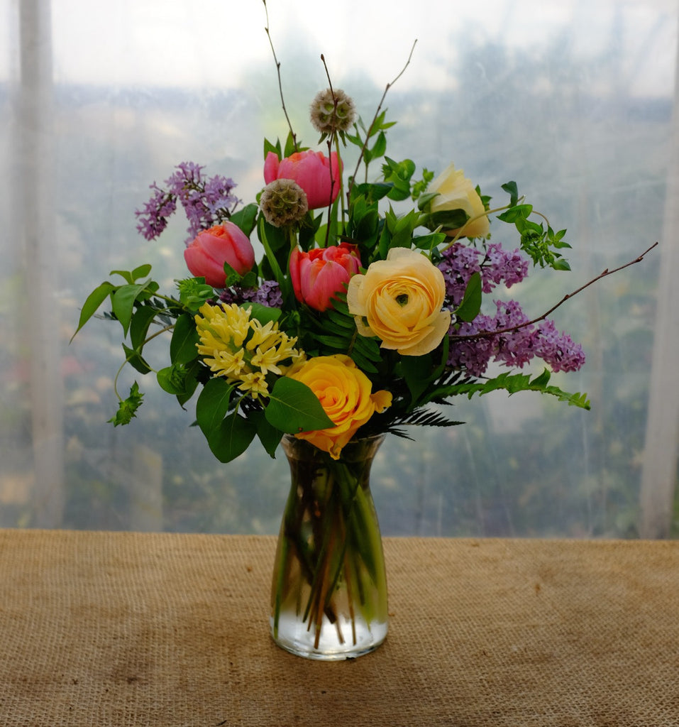 Somerset Flower Bouquet: Pink Tulips, Yellow Ranunculus, Scabiosa Pods and Lilac Flowers.  Designed in Lexington, KY by Michler's Florist