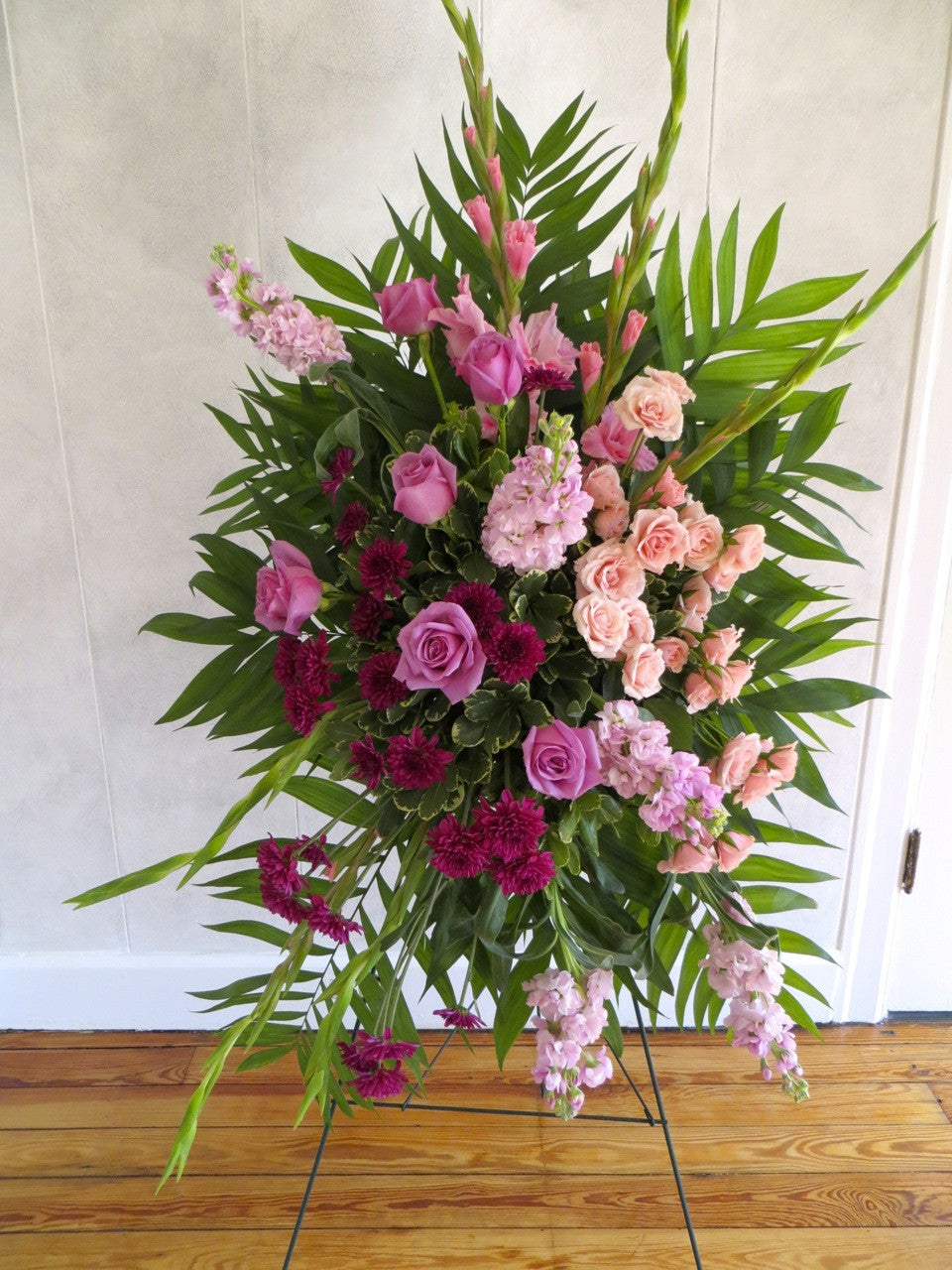 Versailles spray funeral flowers in lexington ky michlers florist easel spray with a gradient from pink flowers to purple designed by michlers florist in izmirmasajfo