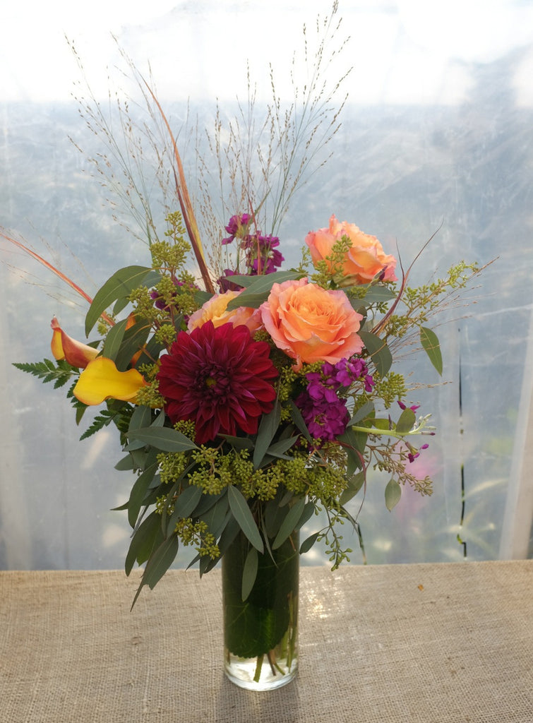 Strathmore: Flower arrangement with burgundy Dahlias, orange Calla Lilies, orange Roses and grasses - Michler's Florist