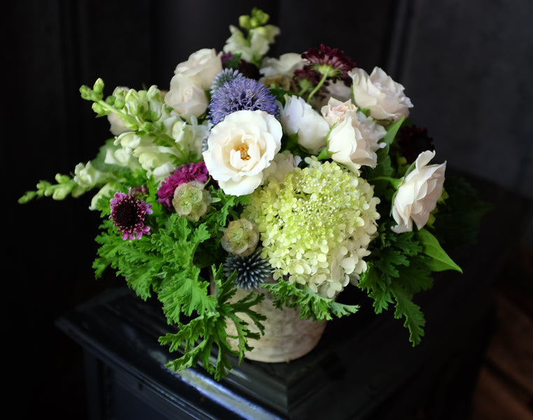 Flower design with Scabiosa, Scented Geraniums, Globe thistle | Michler's Florist