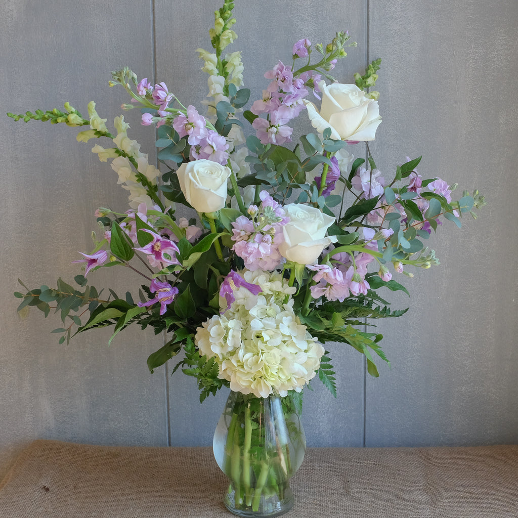 Lavender and white flower bouquet by Michler Florist.