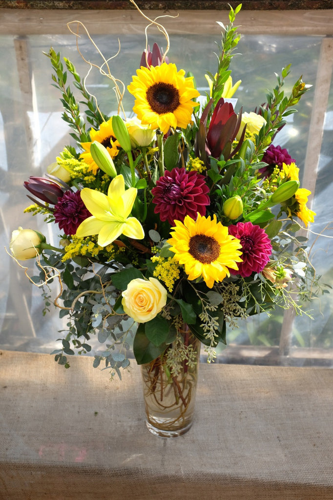 Tremont: Large bright flower arrangement with sunflowers, Celosia, Lilies and Roses - Michler's Florist