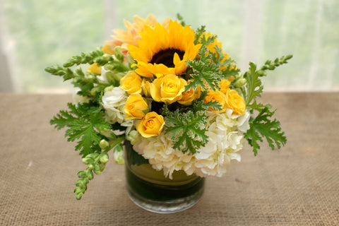 Larkhill: Yellow flower arrangement with Sunflowers, roses and hydrangea. Designed by Michler's Florist in Lexington, KY