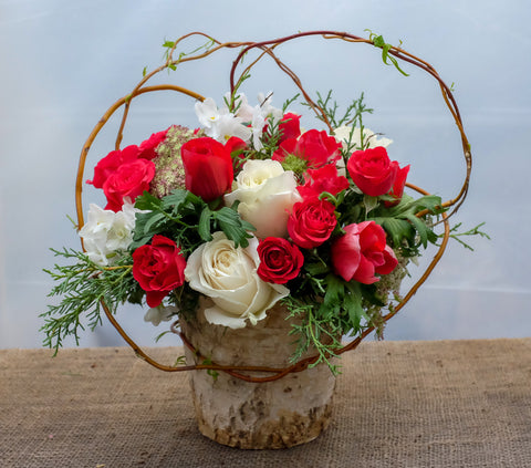 Vienna: flower arrangement in birch pot with red and white roses, designed by Michler's Florist in Lexington, KY