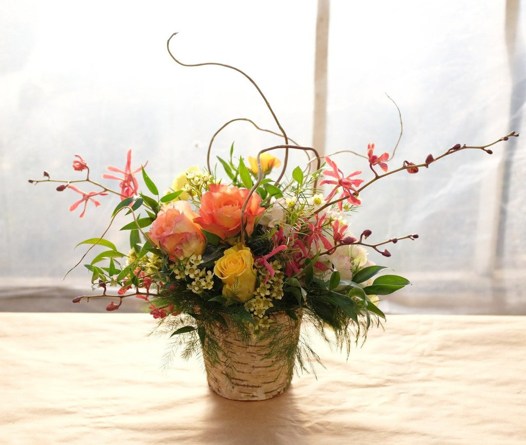Viewmont: Thanksgiving Flowers with Aranthera Orchids and roses in a birch pot.  Michler's Florist