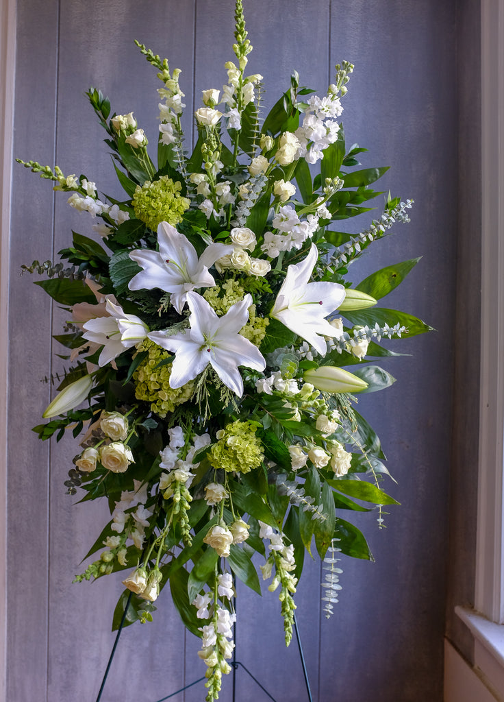 Easel spray of white flowers designed by Michler's Florist