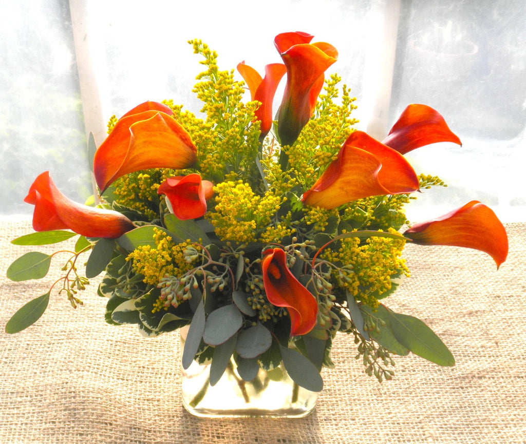 Floral Arrangement by Michler's Florist  with red Calla Lilies and eucalyptus