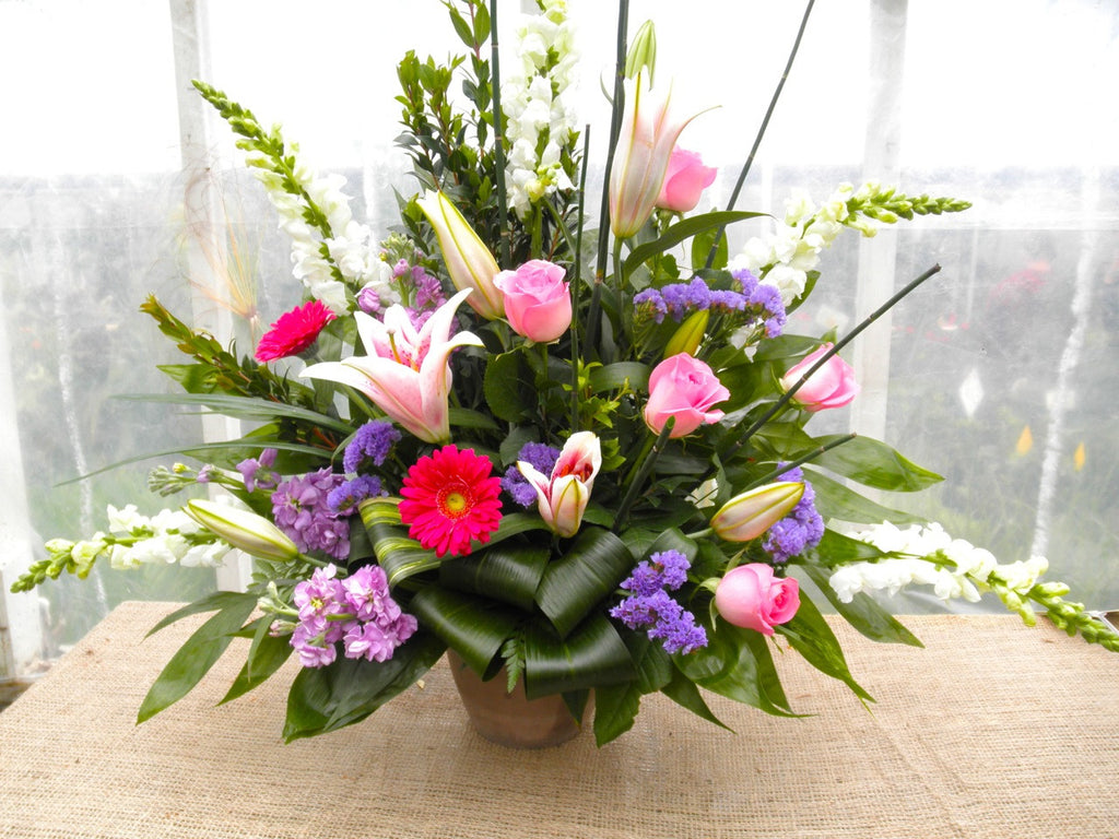 Floral Arrangement by Michler's Florist with Star gazer lilies, pink roses, gerbera daisies