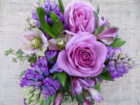 Lavender roses and hyacinth designed in a vase by Michler's Florist in Lexington, KY