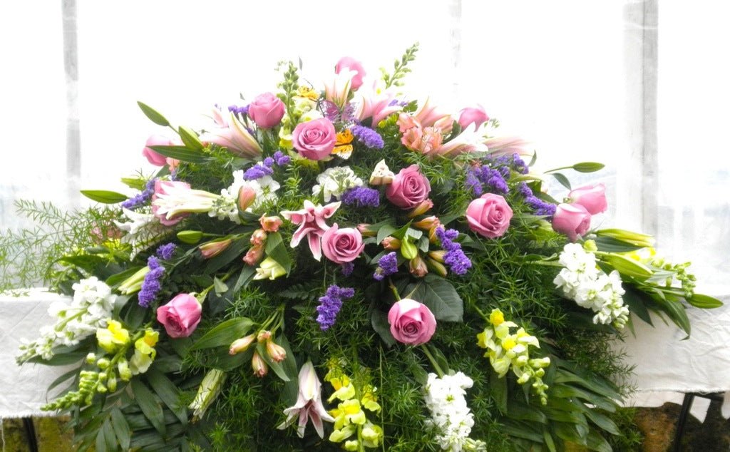 Casket Spray with Lavender, Pink, and Purple Tones. Michler's Florist