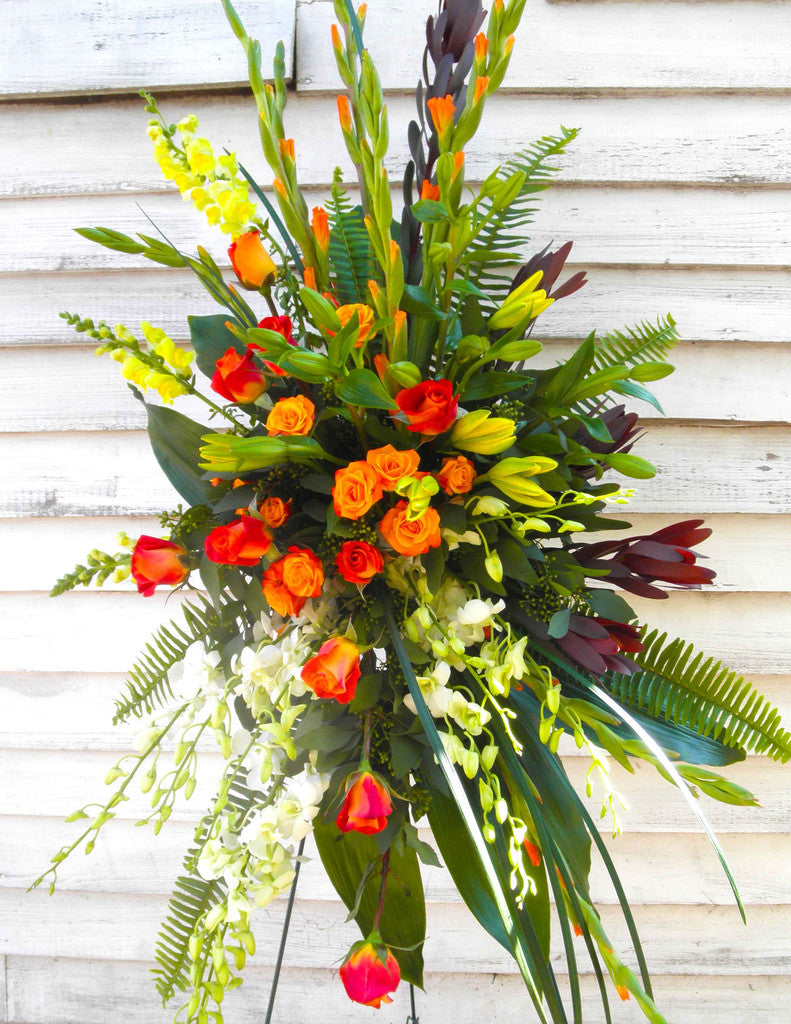 Vibrant Standing Spray: Yellow and Orange Flowers. Designed by Michler's Florist in Lexington, KY