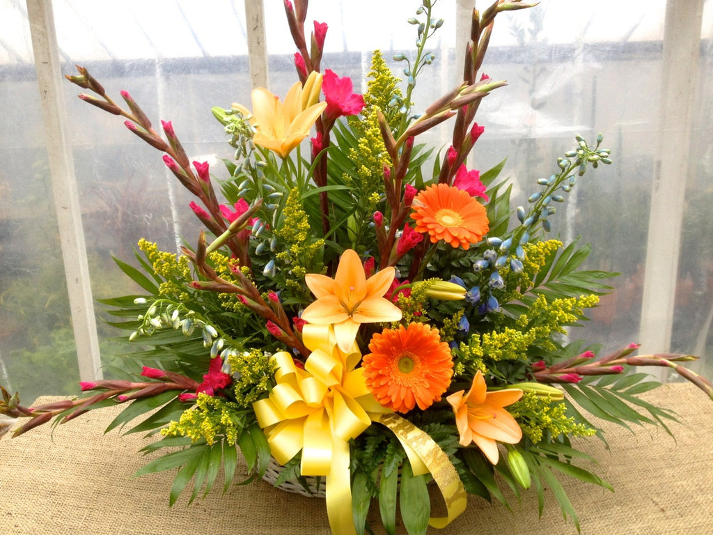 Summer Floral Arrangement by Michler's with orange gerbera daisies, yellow lilies, salidago