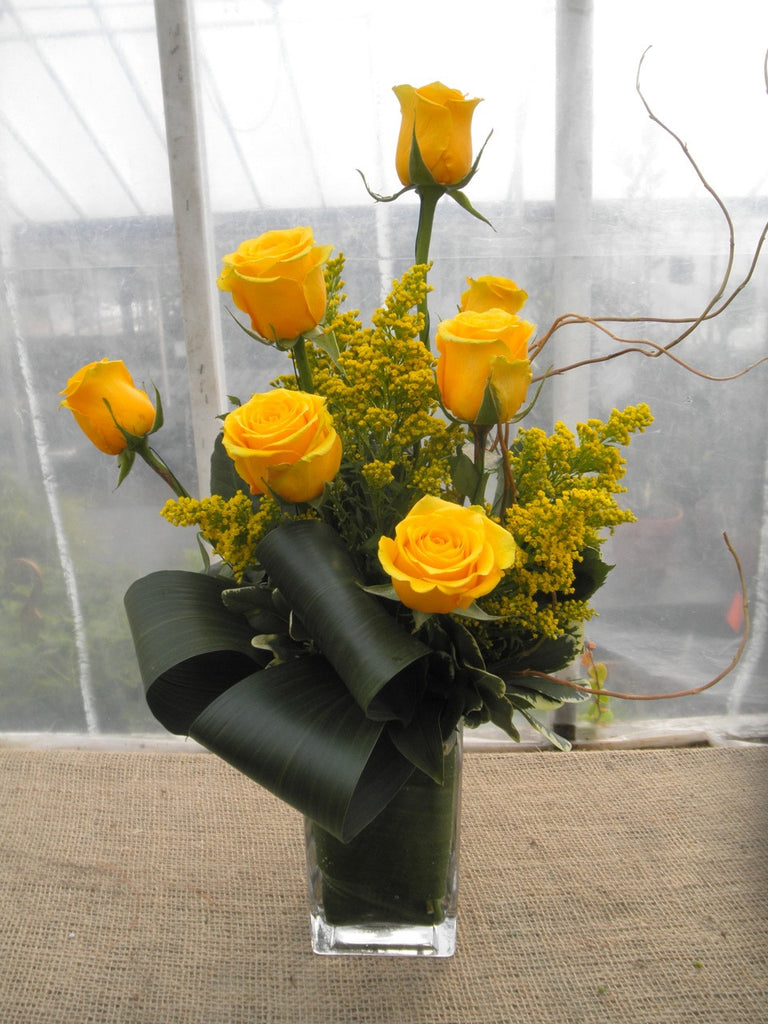 Kenton: Flower arrangement with yellow Roses and Solidago. Designed by Michler's Florist in Lexington, KY
