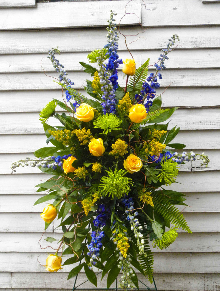 Yellow Farewell Easel Spray with Yellow Roses and Blue Delphinium Designed by Michler's Florist in Lexington, KY