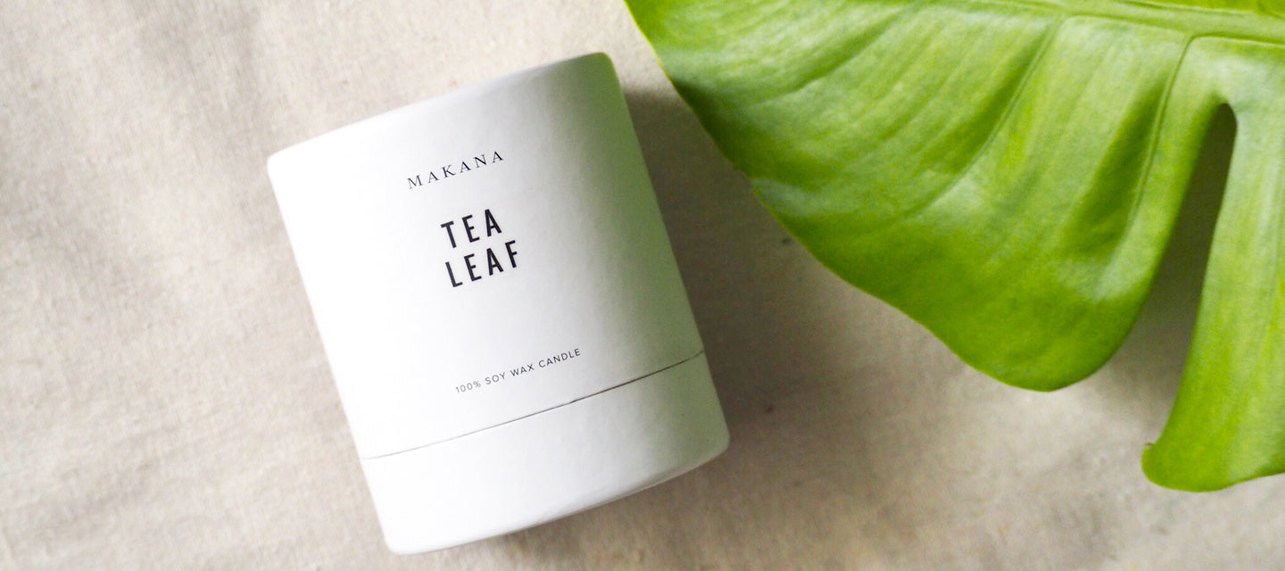 Tea Leaf Candle with Monstera Leaf on Linen Background