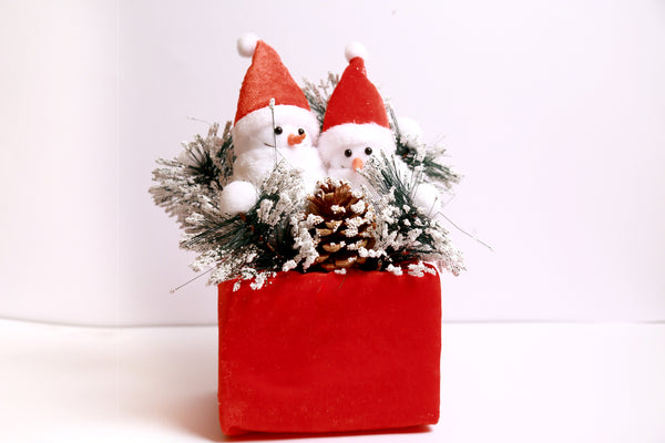 Snowman on Christmas Gift Box with Snow Frosted Pine and Grass Decoration