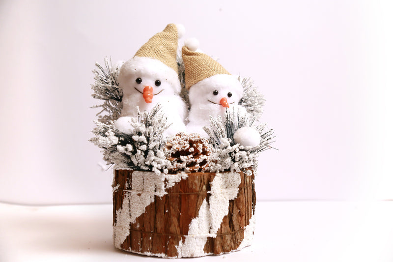 Snowman on Realistic Wooden Log with Snow Frosted Pine and Grass Decoration