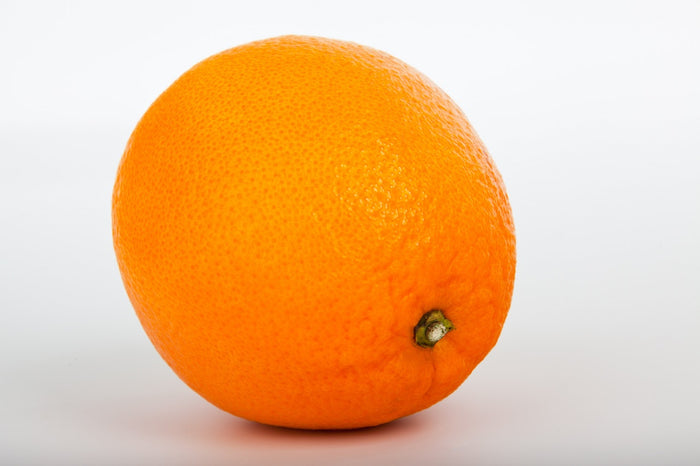 A guy walks into a bar and he has an orange for a head