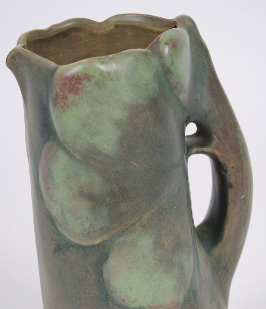 <b> AMPHORA</b><br>PITCHER WITH LARGE GREEN LEAVES, CIRCA 1892-1905</br>
