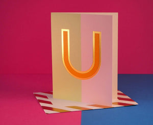 Nixie U foiled letter card