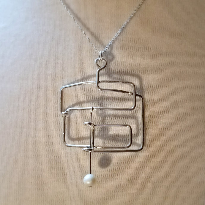 Balanced Geometry with Pearl Pendant