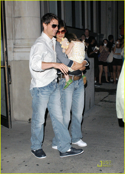 Tom Cruise wearing baggy light wash jeans