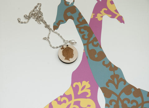 Wooden pendant with silhouette design